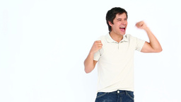 Happy man raising arm and shouting Live Action