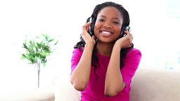 Woman enjoying music with headset Stock Video Footage