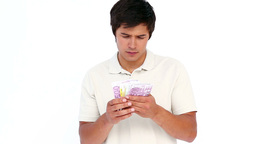 Man counting his banknotes Stock Video Footage