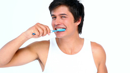 Brunette man brushing his teeth Footage