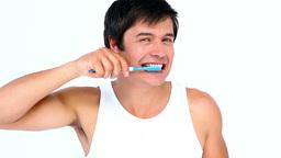 Brunette man brushing his teeth Stock Video Footage