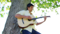 Brunette man playing guitar Stock Video Footage