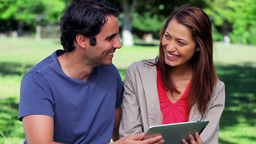 Happy couple holding a tablet computer Footage