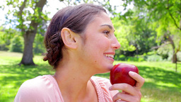 Brunette woman holding a red apple Stock Video Footage