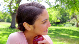 Brunette woman holding a red apple Footage