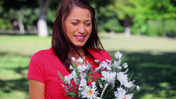 Cheerful woman holding white flowers Stock Video Footage