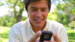 Smiling man using a cellphone Footage
