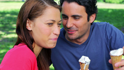 Smiling couple eating cones Stock Video Footage