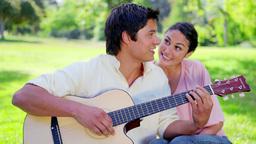 Smiling brunette woman listening to her boyfriend Footage