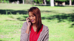 Smiling brunette woman using a mobile phone Stock Video Footage