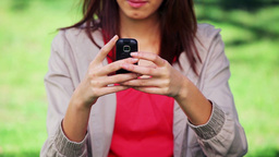 Serious woman typing on her cellphone Stock Video Footage
