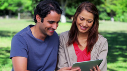 Smiling couple looking at a tablet pc Footage