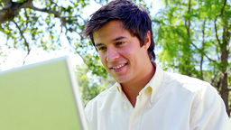 Happy man using his laptop Stock Video Footage