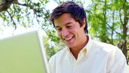 Happy man using his laptop Footage