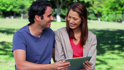 Happy couple looking at a tablet computer Footage