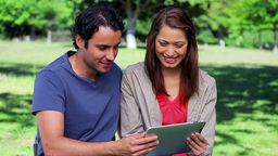 Happy couple holding a tablet pc together Footage
