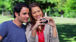 Smiling couple taking a picture of themselves Footage