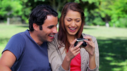 Smiling couple taking a picture of themselves Stock Video Footage