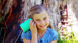 Girl using a can phone Stock Video Footage