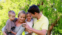 Family taking a picture with a digital camera Footage