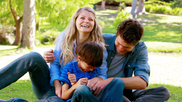 Couple tickling their son Stock Video Footage