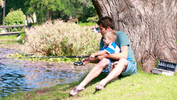 Man teaches to his son fishing Stock Video Footage