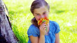 Little girl smelling a flower Live Action