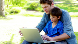 Son and his father using a laptop Stock Video Footage
