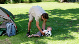 Father and son playing with a football Footage
