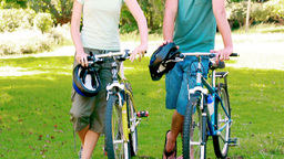 Young couple standing with bikes Footage