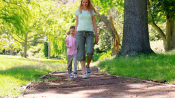 Young woman walking with a girl Stock Video Footage