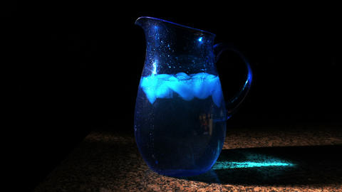 1715 Blue Pitcher with Ice Falling into Water, 4K Footage