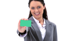 Brunette holding a business card Footage