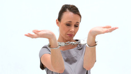 Brunette woman wearing handcuffs Stock Video Footage