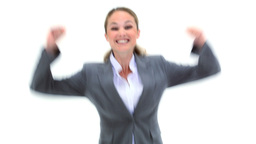 Businesswoman raising her arms Stock Video Footage