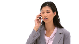 Brunette woman talking on her mobile phone Stock Video Footage