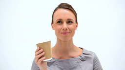Brunette woman holding a cup of coffee Footage