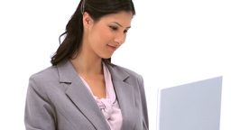 Brunette woman typing on a laptop Footage