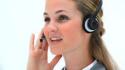 Smiling woman using a headset Footage