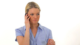 Blonde woman talking on her cellphone Stock Video Footage