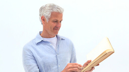 Mature man reading a book Live Action