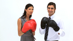 Smiling friends using boxing gloves Footage