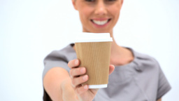 Smiling woman holding a cup of coffee Footage