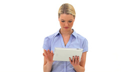 Blonde woman using a tablet computer Stock Video Footage