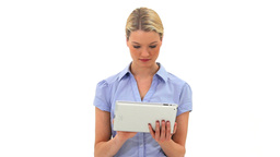 Blonde woman using a tablet computer Footage