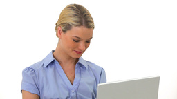 Blonde woman using a laptop Stock Video Footage