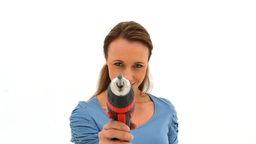 Woman playing with a power drill Stock Video Footage