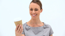 Smiling woman holding a cup of tea Stock Video Footage