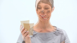 Smiling woman holding a cup of tea Footage