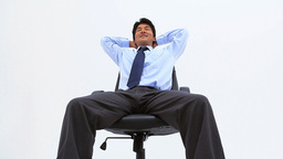 Smiling man sitting on a swivel chair Stock Video Footage